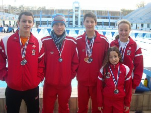 The medNeptunes swimmers who won medals in Berlin from left to right:  Julian Harding, Michael Umnov, Neil Muscat, Amy Micallef and young Mya Azzopardi.al winners