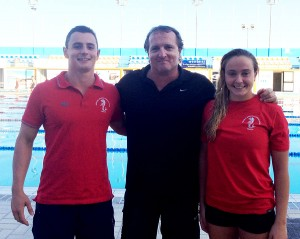 Neptunes swimmers Julian Harding and Amy Micallef with National Coach Andy Colburn